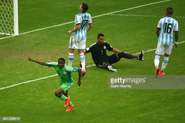 Ahmed Musa of Nigeria celebrates scoring his team's second goal and his second of the game past Sergio Romero of Argentina during the 2014 FIFA World...