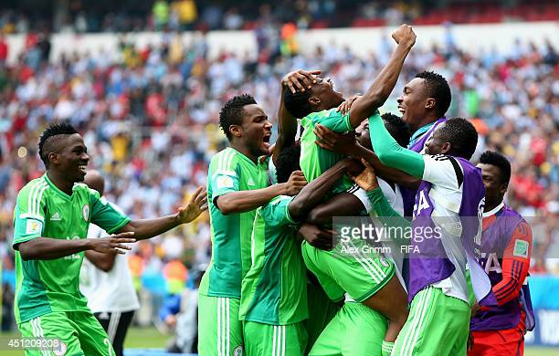 Ahmed Musa of Nigeria celebrates scoring his team's second goal with his teammates during the 2014 FIFA World Cup Brazil Group F match between...