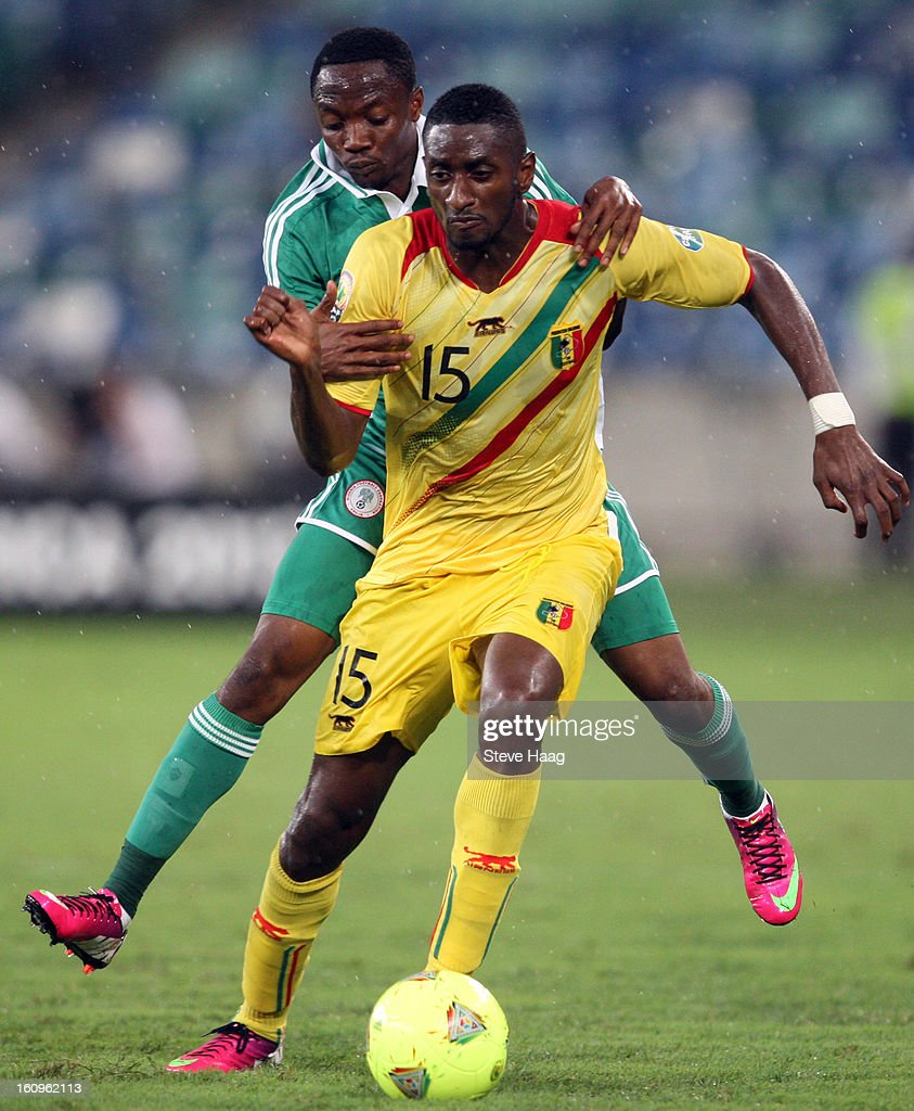 Ahmed Musa of Nigeria clashes with Mamadou Samassa of Mali during the 2013 African Cup of Nations Semi-Final match between Mali and Nigeria at Moses Mahbida Stadium on February 06, 2013 in Durban, South Africa.