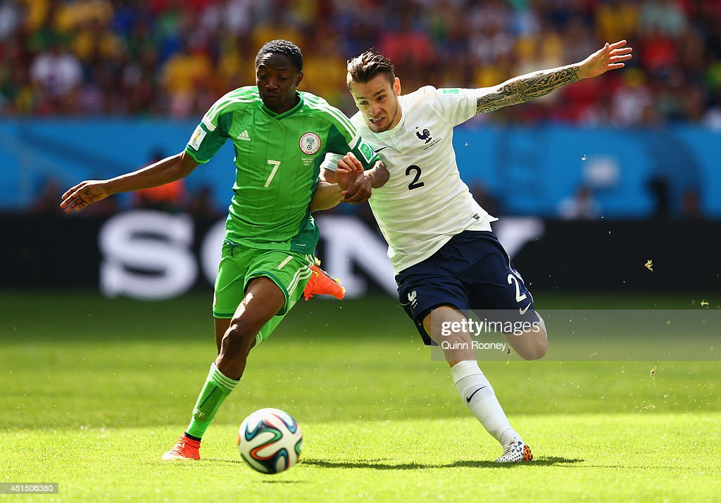 Ahmed Musa of Nigeria competes for the ball with <a gi-track='captionPersonalityLinkClicked' href=/galleries/search?phrase=Mathieu+Debuchy&family=editorial&specificpeople=729104 ng-click='$event.stopPropagation()'>Mathieu Debuchy</a> of France during the 2014 FIFA World Cup Brazil Round of 16 match between France and Nigeria at Estadio Nacional on June 30, 2014 in Brasilia, Brazil.
