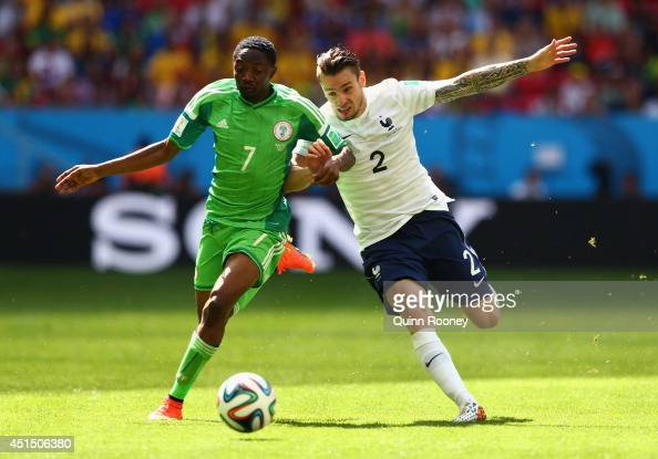 Ahmed Musa of Nigeria competes for the ball with Mathieu Debuchy of France during the 2014 FIFA World Cup Brazil Round of 16 match between France and...