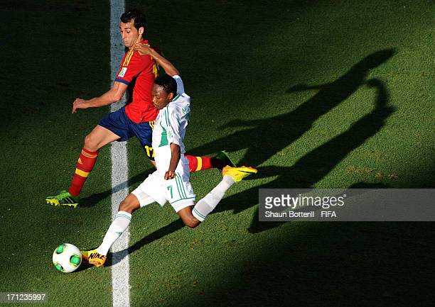Ahmed Musa of Nigeria shoots past Alvaro Arbeloa of Spain during the FIFA Confederations Cup Brazil 2013 Group B match between Nigeria and Spain at...