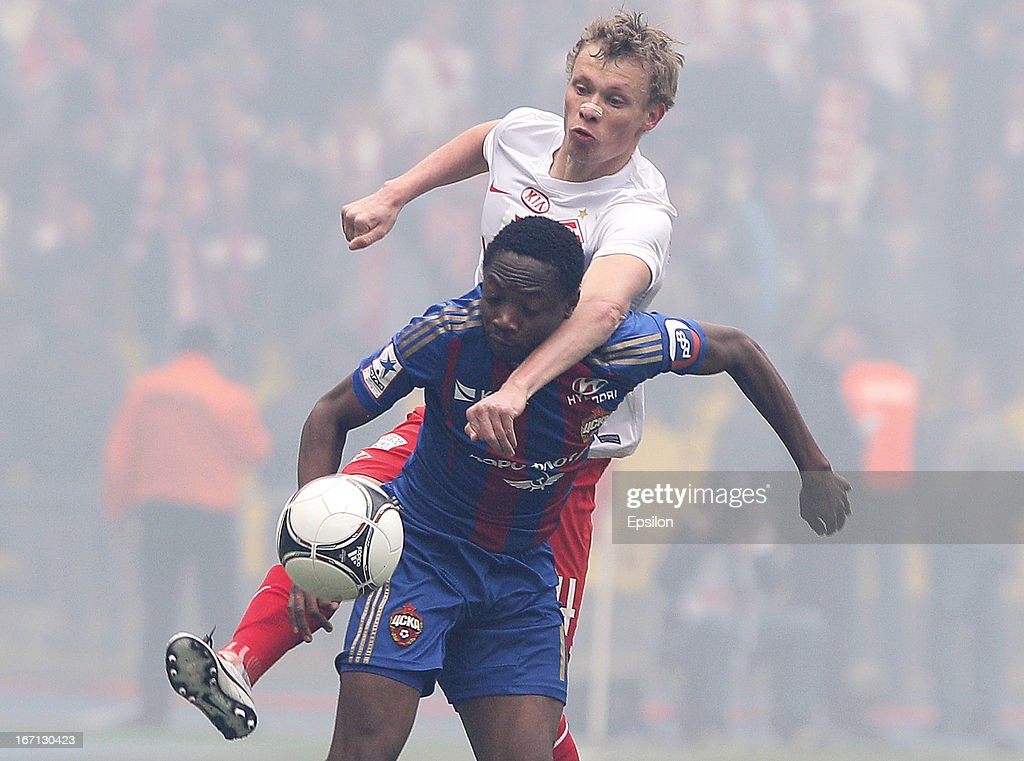 Ahmed Musa of PFC CSKA Moscow is challenged by Yevgeni Makeyev (Top) of FC Spartak Moscow during the Russian Premier League match between PFC CSKA Moscow and FC Spartak Moscow at the Luzhniki Stadium on April 21, 2013 in Moscow, Russia.