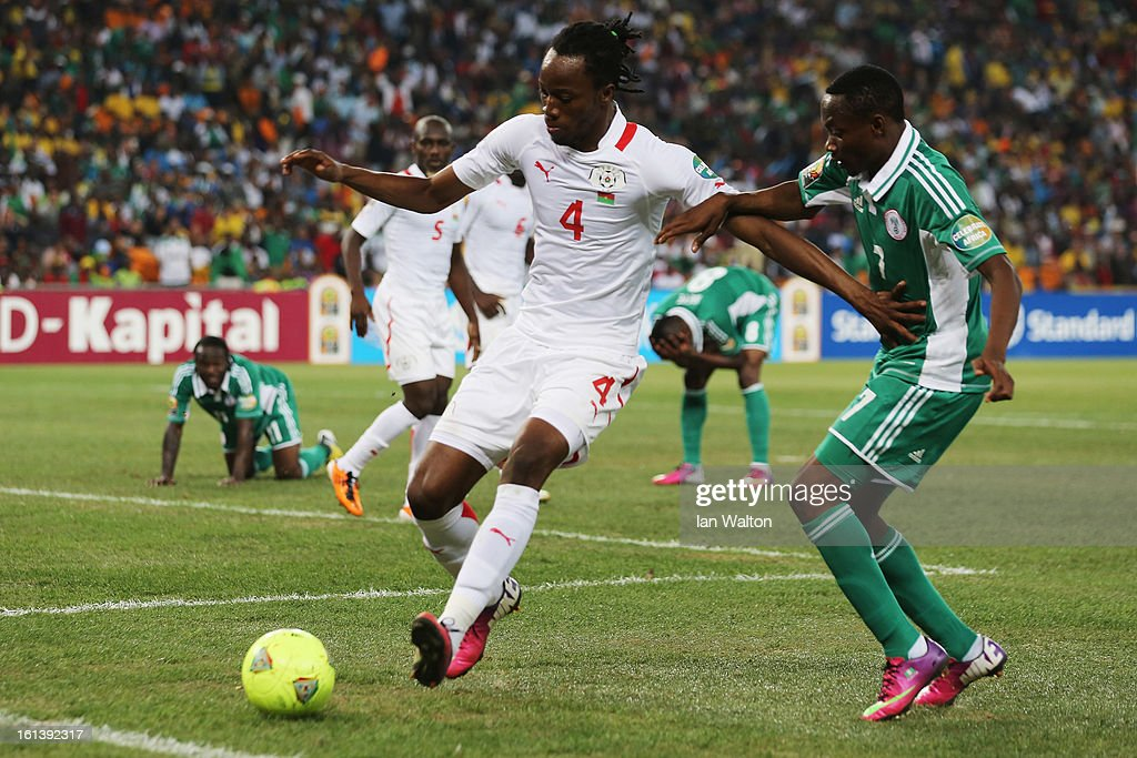 Ahmed Musaab of Nigeria tries to tackle Bakary Kone of Burkina Faso during the 2013 Africa Cup of Nations Final match between Nigeria and Burkina at FNB Stadium on February 10, 2013 in Johannesburg, South Africa.