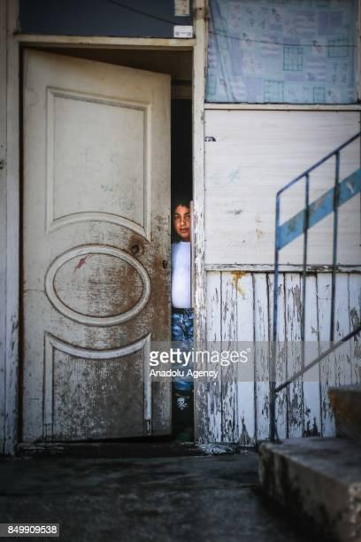 Ahmed Mustafa Elhalef looks behind of a half way open door in Altindag district of Ankara Turkey on July 26 2017 Ahmed Mustafa Elhalef lost his...
