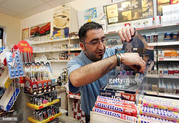 Ahmed Mutlu works in his kiosk in the centre of KampLintfort Germany on Monday August 23 2005 Two years ago Mutlu moved to KampLintfort from nearby...