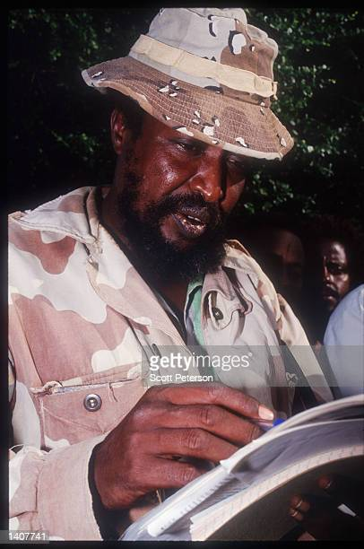 Ahmed Omar Jess Chairman of the Somali Patriotic Movement with his rebels June 15 1992 Kismayo Somalia Mr Omar Jess is the second strongest warlord...