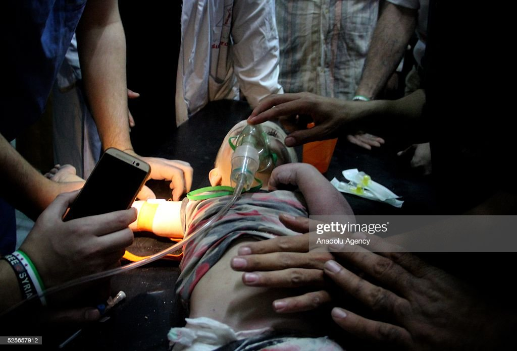 Ahmed Recep, 2, a Syrian toddler who has been rescued from the wreckage, receives treatment at a hospital after the war crafts belonging to the Russian army carried out airstrikes on Jerusalem Sahra hospital in the Sukkeri neighborhood of Aleppo, Syria on April 28, 2016.
