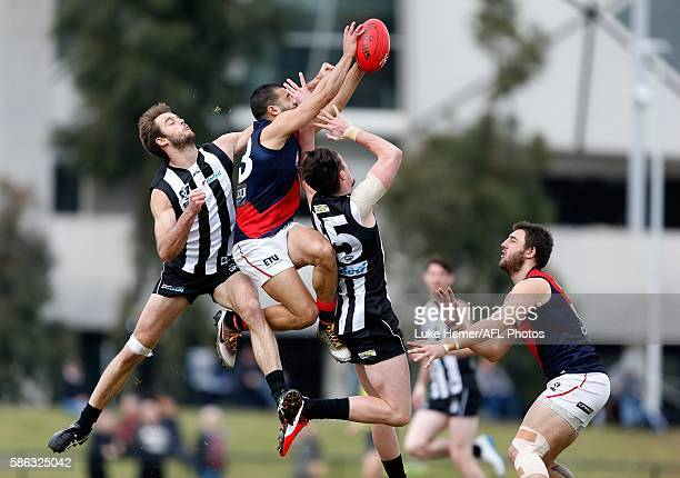 Ahmed Saad of Coburg bursts through the pack during the round 18 VFL match between Collingwood and Coburg at The Holden Centre on August 6 2016 in...