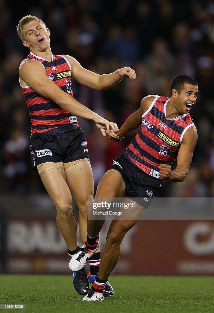Ahmed Saad (R) of the Saints celebrates a goal with Sebastian Ross during the round seven AFL match between the St Kilda Saints and the Carlton Blues at Etihad Stadium on May 13, 2013 in Melbourne, Australia.