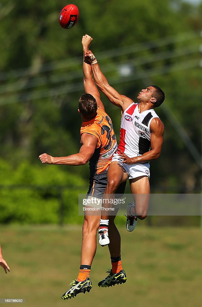 Ahmed Saad of the Saints competes with Tim Mohr of the Giants during the AFL practice match between the Greater Western Sydney Giants and the St Kilda Saints at Blacktown International Sportspark on March 16, 2013 in Sydney, Australia.