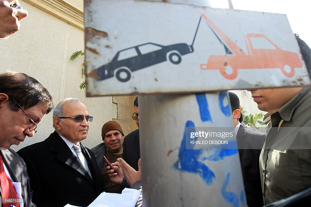 Ahmed Shafiq (2nd L), the last prime minister to serve under Hosni Mubarak, speaks to the press after registering his candidacy for the presidential election in Cairo on March 10, 2012 as Egypt's presidential race kicked off.