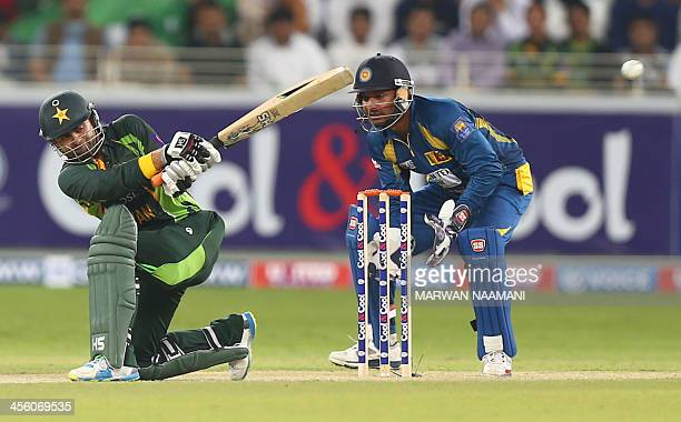 Ahmed Shahzad of Pakistan plays a shot during the 2nd T20 match between Sri Lanka and Pakistan in Dubai on December 13 2013 AFP PHOTO/MARWAN NAAMANI