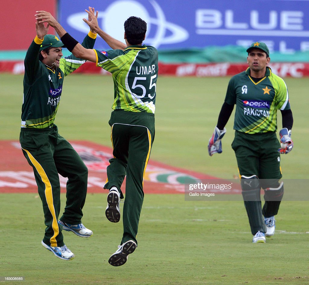 Ahmed Shehzad and Umar Gul of Pakistan celebrate the wickey of Faf du Plessis of South Africa during the 2nd T20 match between South Africa and Pakistan at SuperSport Park on March 03, 2013 in Pretoria, South Africa