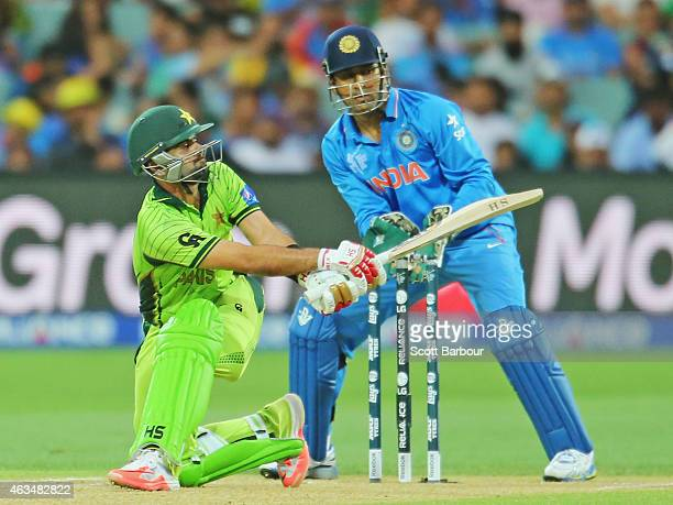 Ahmed Shehzad of Pakistan bats as wicketkeeper MS Dhoni of India looks on during the 2015 ICC Cricket World Cup match between India and Pakistan at...