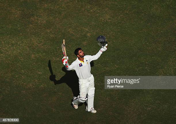 Ahmed Shehzad of Pakistan celebrates after reaching his century during Day Four of the First Test between Pakistan and Australia at Dubai...
