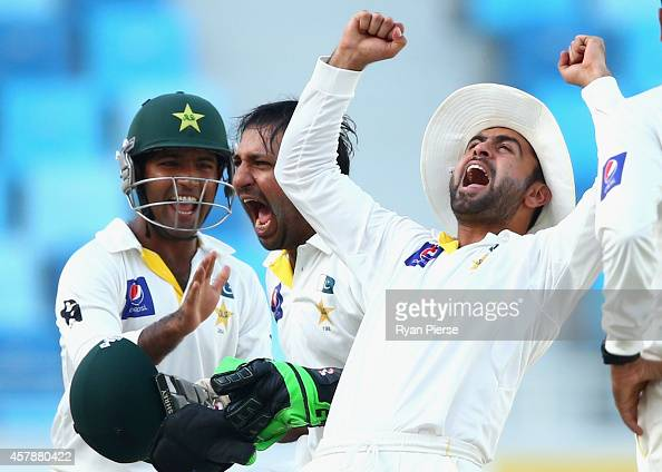 Ahmed Shehzad of Pakistan celebrates after Yasir Shah oand Sarfraz Ahmed of Pakistan claimed the wicket of Mohammad Talha of Pakistan during Day Five...