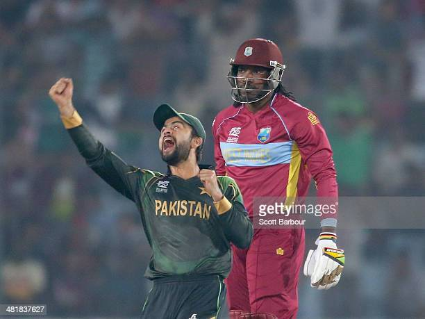 Ahmed Shehzad of Pakistan celebrates the dismissal of Chris Gayle of the West Indies during the ICC World Twenty20 Bangladesh 2014 match between West...