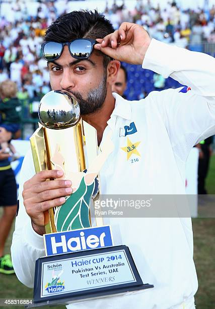 Ahmed Shehzad of Pakistan celebrates with the trophy after Pakistan won the series 20 during Day Five of the Second Test between Pakistan and...