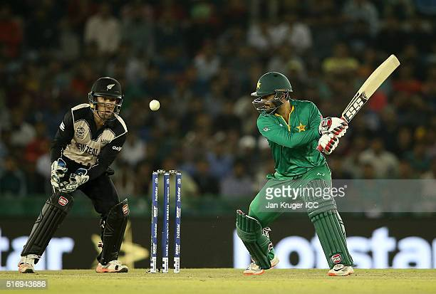 Ahmed Shehzad of Pakistan cuts the ball with Luke Ronchi of New Zealand looking on during the ICC World Twenty20 India 2016 Super 10s Group 2 match...