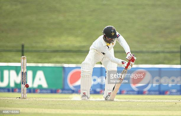 Ahmed Shehzad of Pakistan is bowled by Mitchell Johnson of Australia during Day Three of the Second Test between Pakistan and Australia at Sheikh...