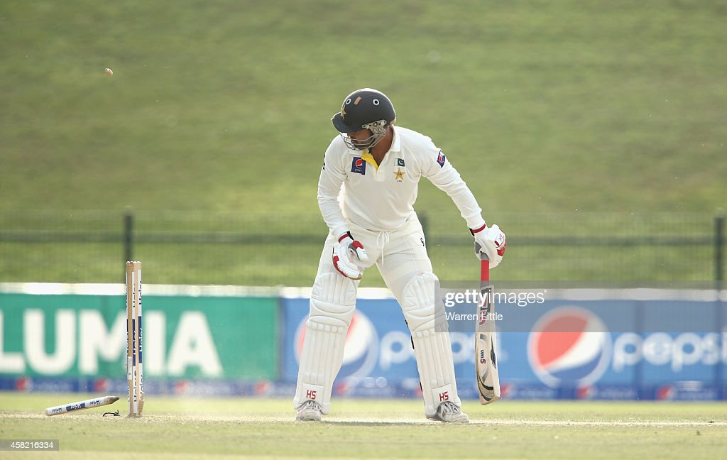 Ahmed Shehzad of Pakistan is bowled by Mitchell Johnson of Australia during Day Three of the Second Test between Pakistan and Australia at Sheikh Zayed Stadium on November 1, 2014 in Abu Dhabi, United Arab Emirates.