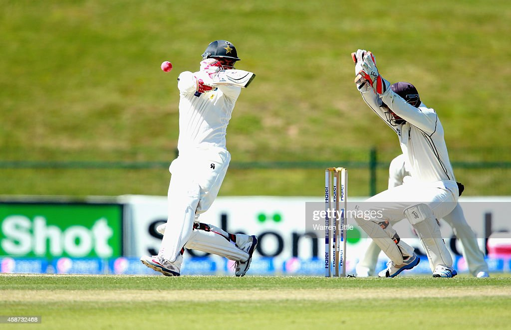 <a gi-track='captionPersonalityLinkClicked' href=/galleries/search?phrase=Ahmed+Shehzad&family=editorial&specificpeople=5893396 ng-click='$event.stopPropagation()'>Ahmed Shehzad</a> of Pakistan is hit on the head and tumlbes into his wicket from the bowling of <a gi-track='captionPersonalityLinkClicked' href=/galleries/search?phrase=Corey+Anderson+-+Cricket+Player&family=editorial&specificpeople=12457249 ng-click='$event.stopPropagation()'>Corey Anderson</a> of New Zealand during day two of the first test between Pakistan and New Zealand at Sheikh Zayed stadium on November 10, 2014 in Abu Dhabi, United Arab Emirates.