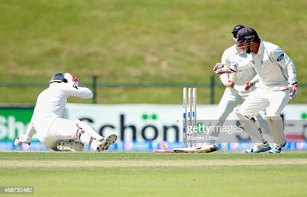 Ahmed Shehzad of Pakistan is hit on the head and tumlbes into his wicket from the bowling of Corey Anderson of New Zealand during day two of the...