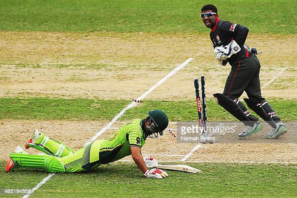 Ahmed Shehzad of Pakistan is run out during the 2015 ICC Cricket World CUp match between Pakistan and the United Arab Emirates at McLean Park on...