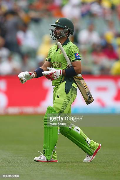 Ahmed Shehzad of Pakistan looks dejected after being dismissed by Josh Hazlewood of Australia during the 2015 ICC Cricket World Cup match between...