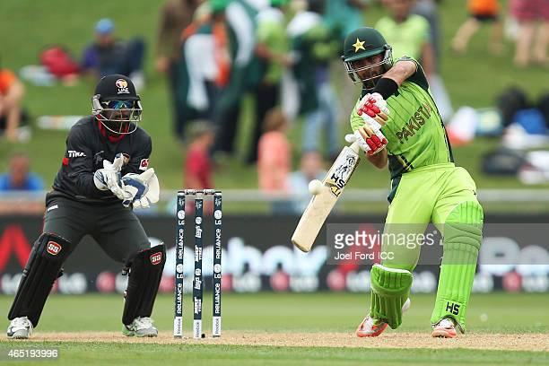 Ahmed Shehzad of Pakistan plays a shot during the 2015 ICC Cricket World Cup match between Pakistan and the United Arab Emirates at McLean Park on...