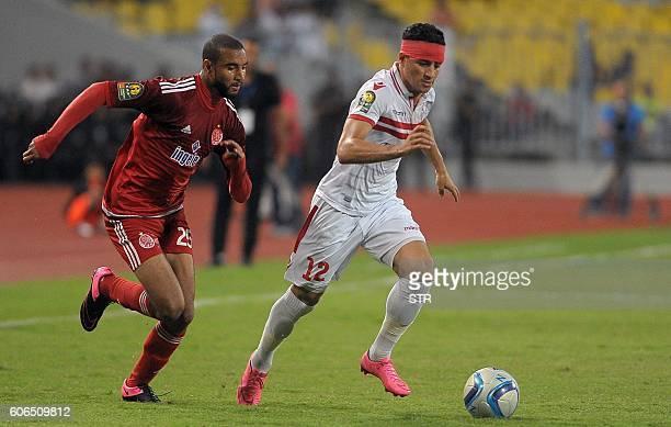 Ahmed Tawfik of Egypts Zamalek club fights for the ball with Ismail El Haddad of Moroccos Wydad Athletic Club during their CAF Champions League...