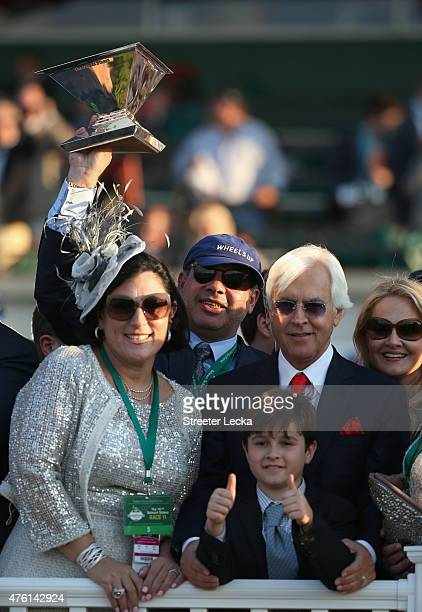 Ahmed Zayat owner of American Pharaoh and trainer Bob Baffert celebrate with the Triple Crown Trophy after winning the 147th running of the Belmont...