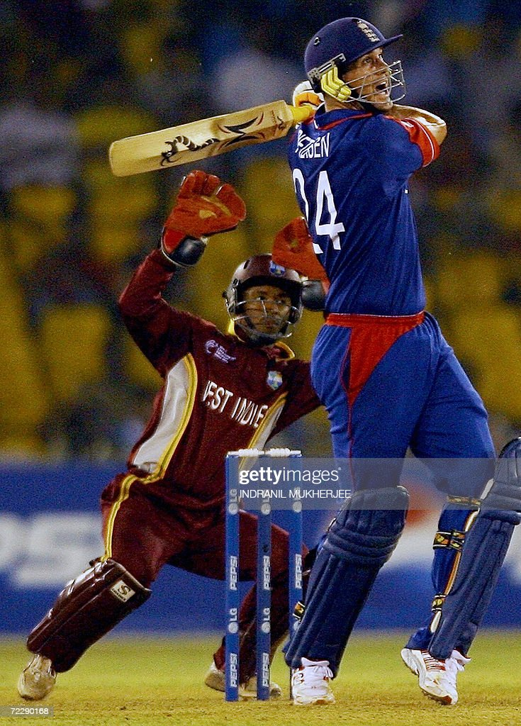 West Indian cricketer Carlton Baugh (L) reacts as England cricketer <a gi-track='captionPersonalityLinkClicked' href=/galleries/search?phrase=Kevin+Pietersen+-+Cricket+Player&family=editorial&specificpeople=202001 ng-click='$event.stopPropagation()'>Kevin Pietersen</a> plays a shot during the ICC Champions Trophy 2006 match between the West Indies and England in Ahmedabad, 28 October 2006. England needing 273 runs to win have scored 174 runs for 4 wickets in 35 overs. AFP PHOTO/ Indranil MUKHERJEE