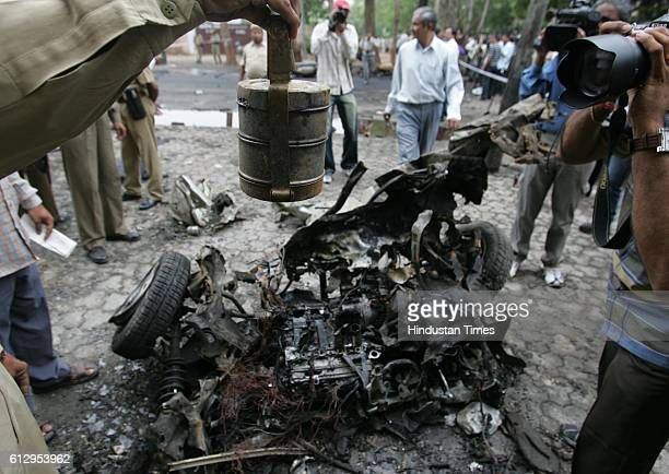 Ahmedabad serial Bomb blasts Policemen inspect the site where two blasts took place at Civil Hospital A burnt tiffin box was collected as evidence