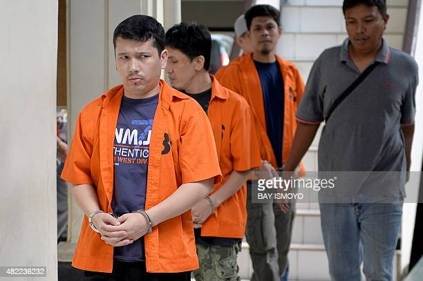 Ahmet Bozoglan a member of China's Uighur minority walks for his appearance at the North Jakarta District Court on terrorism charges in Jakarta on...