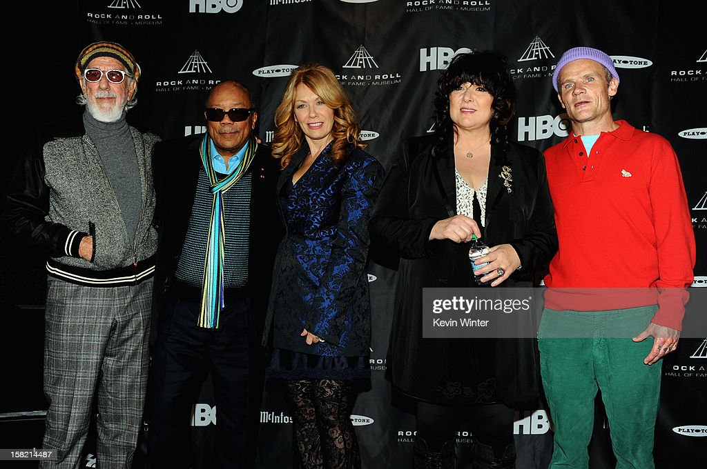 Ahmet Ertegun Award recipients <a gi-track='captionPersonalityLinkClicked' href=/galleries/search?phrase=Lou+Adler+-+Record+Producer&family=editorial&specificpeople=228945 ng-click='$event.stopPropagation()'>Lou Adler</a> and <a gi-track='captionPersonalityLinkClicked' href=/galleries/search?phrase=Quincy+Jones&family=editorial&specificpeople=171797 ng-click='$event.stopPropagation()'>Quincy Jones</a> stand with inductees Ann Wilson and Nancy Wilson of Heart and <a gi-track='captionPersonalityLinkClicked' href=/galleries/search?phrase=Flea+-+Musician&family=editorial&specificpeople=213900 ng-click='$event.stopPropagation()'>Flea</a> during the Rock and Roll Hall of Fame 2013 Inductees announcement at Nokia Theatre L.A. Live on December 11, 2012 in Los Angeles, California.