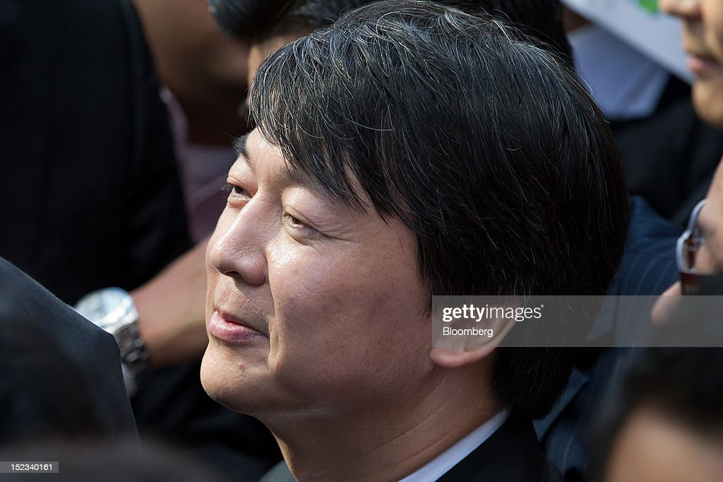 Ahn Cheol Soo, chairman of Ahnlab Inc., leaves a news conference after announcing his presidential candidacy in Seoul, South Korea, on Wednesday, Sept. 19, 2012. Ahn, founder of South Korea's biggest antivirus software maker, said he will run as an independent in the December presidential race to succeed Lee Myung Bak. Photographer: SeongJoon Cho/Bloomberg via Getty Images