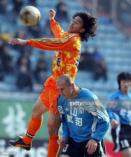Ahn Junghwa of Shimizu SPulse battles for the ball with Zoran Jankovic of Dalian Shide during the AFC Champions League Group B match at the Dalian...