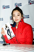 Ahn SoHee of South Korean girl group Wonder Girls attends an autograph session for 'Tommy Hilfiger' Denim at Hyundai Department Store on November 9...