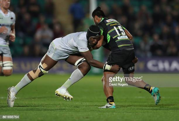 Ahsee Tuala of Northampton is tackled by Maro Itoje during the European Rugby Champions Cup match between Northampton Saints and Saracens at...