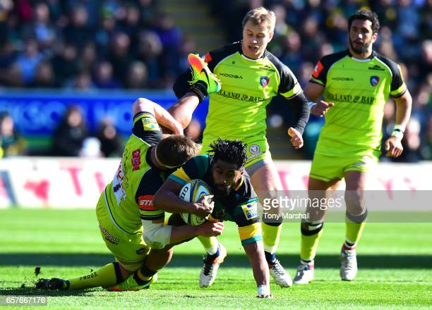 Ahsee Tuala of Northampton Saints is tackled by Brendon O'Connor of Leicester Tigers during the Aviva Premiership match between Northampton Saints...