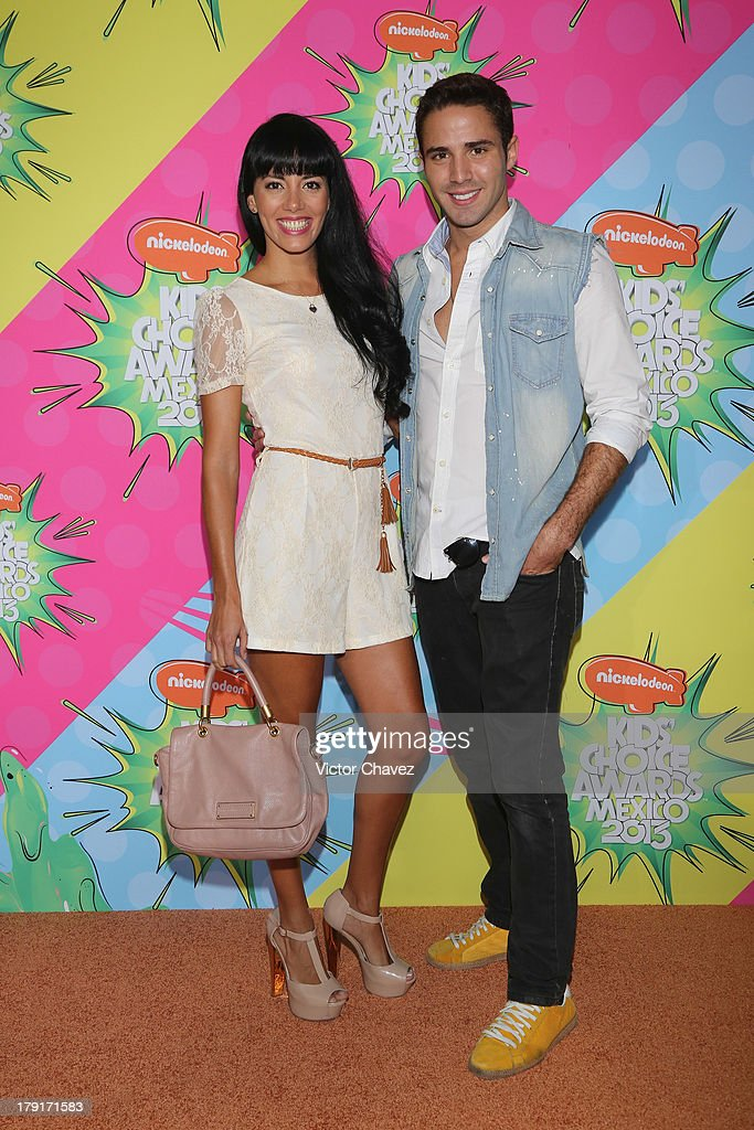 Ahyrin Ollarves and Roman Camara arrive at Kids Choice Awards Mexico 2013 at Pepsi Center WTC on August 31, 2013 in Mexico City, Mexico.