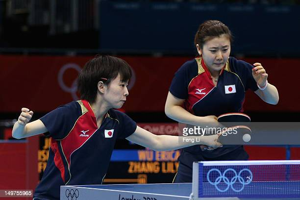 Ai Fukuhara and Kasumi Ishikawa of Japan competes during Women's Team Table Tennis first round match against team of United States on Day 7 of the...