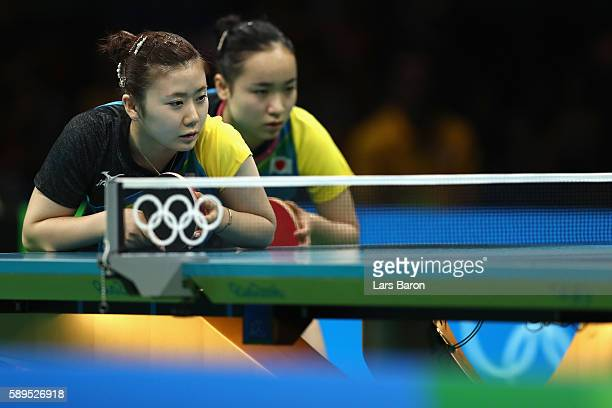 Ai Fukuhara and Mima Ito of Japan look on during the Women's Team Semifinal 2 against Xiaona Shan and Petrissa Solja of Germany on Day 9 of the Rio...