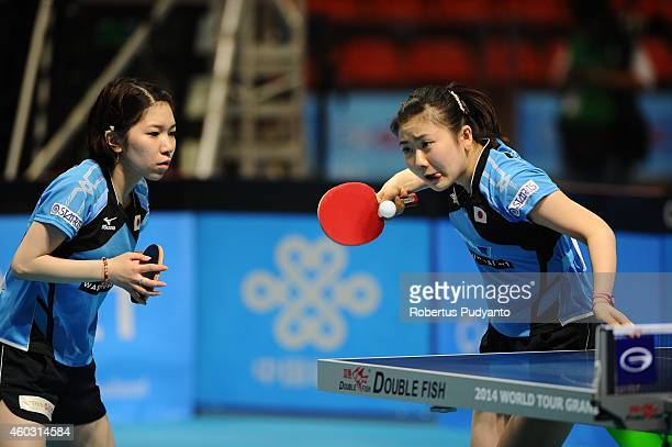 Ai Fukuhara and Misako Wakamiya of Japan in action during Women's double quarter final of the 2014 ITTF World Tour Grand Finals at Huamark Indoor...