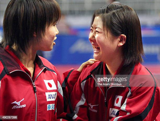 Ai Fukuhara and Sayaka Hirano of Japan celebrate winning against Hungary in the Women's Team Quarter final during the 2008 World Team Table Tennis...