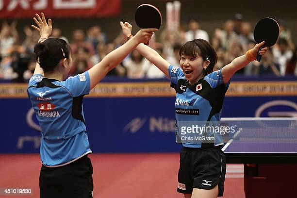 Ai Fukuhara and team mate Misako Wakamiya celebrate victory against Feng Tianwei and Yu Mengyu of Singapore during the Women's Doubles Final on day...