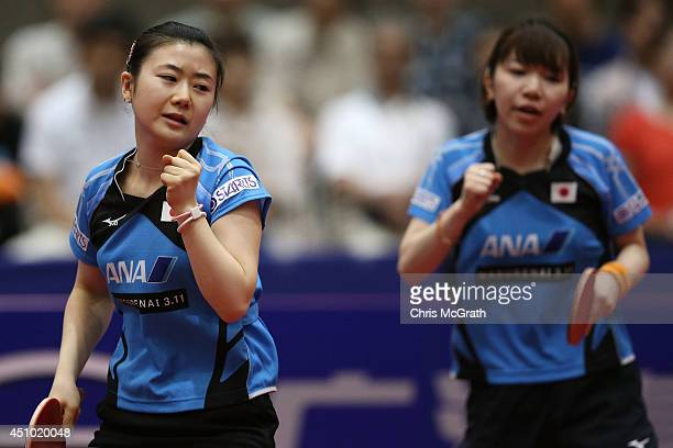 Ai Fukuhara and team mate Misako Wakamiya of Japan celebrate a point against Feng Tianwei and Yu Mengyu of Singapore during the Women's Doubles Final...