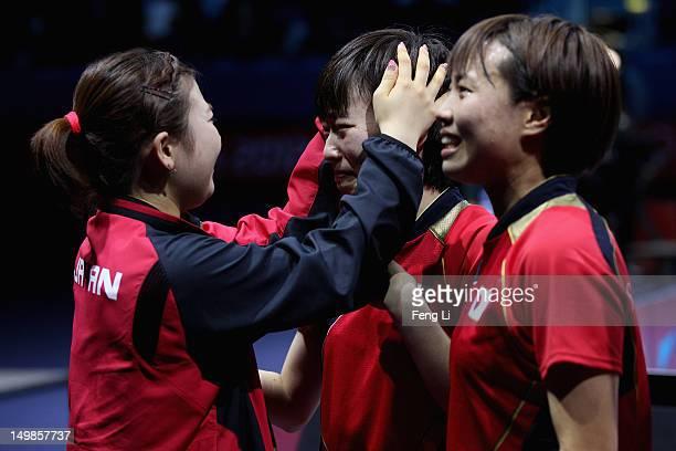 Ai Fukuhara Kasumi Ishikawa and Sayaka Hirano of Japan celebrate after winning Women's Team Table Tennis semifinal match against team of Singapore on...